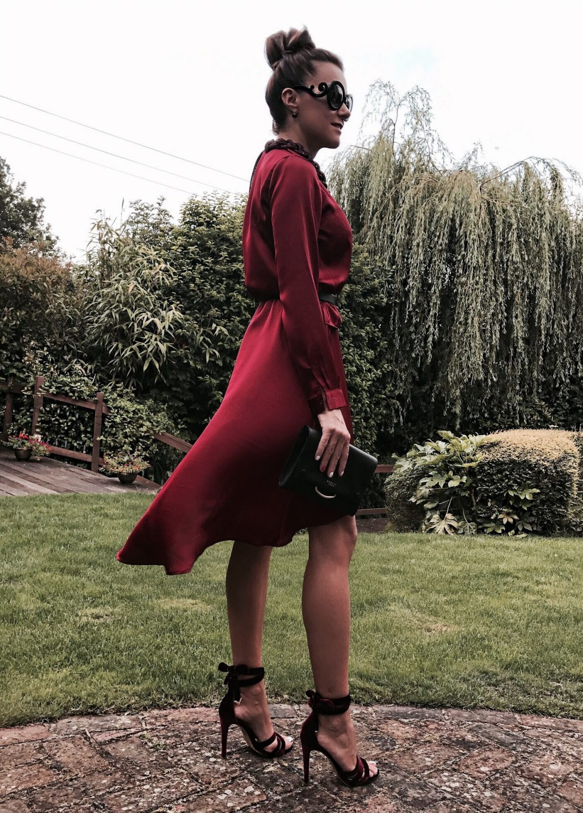 Radley, necklace, heeled sandals, black clutch, satin dress, burgundy dress, Prada sunglasses